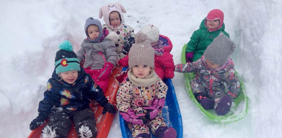 Toddlers enjoying some time sledding while at Paradise Place Preschool.
